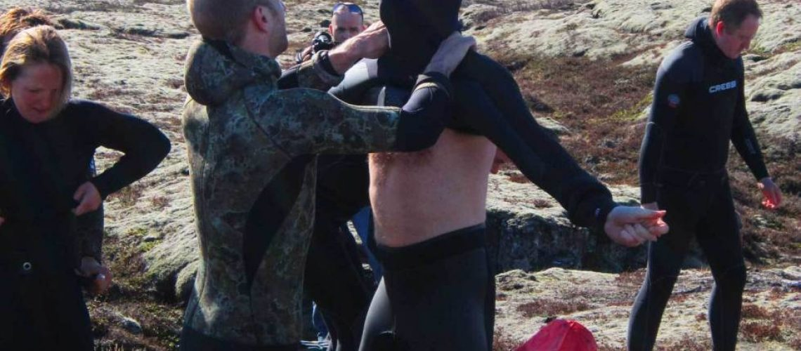 putting-on-a-freediving-wetsuit